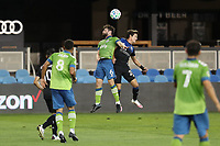 SAN JOSE, CA - OCTOBER 18: Joao Paulo #6 of the Seattle Sounders goes up for a header with Carlos Fierro #21 of the San Jose Earthquakes during a game between Seattle Sounders FC and San Jose Earthquakes at Earthquakes Stadium on October 18, 2020 in San Jose, California.