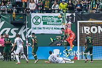 Portland, Oregon - Sunday September 22, 2019: Steve Clark #12 punches the ball clear during a regular season game between Portland Timbers and Minnesota United at Providence Park on September 22, 2019 in Portland, Oregon.