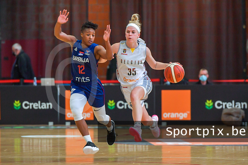 Yvonne Anderson (12) of Serbia and Julie Vanloo (35) of Belgium pictured during a basketball game between the national teams of Belgium , called the Belgian Cats , and Serbia on Friday 28 th of May 2021 in Kortrijk , Belgium . PHOTO SPORTPIX.BE   SPP   STIJN AUDOOREN
