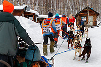 Volunteers from Norway park Bradley Farquar's dogs for a 24-hour layover in the afternoon at the Takotna checkpoint during the 2018 Iditarod race on Wednesday March 07, 2018. <br /> <br /> Photo by Jeff Schultz/SchultzPhoto.com  (C) 2018  ALL RIGHTS RESERVED