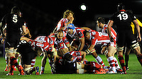 Mariano Galarza (blue scrum cap) and Charlie Sharples of Gloucester Rugby set up the next phase of play