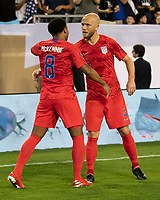NASHVILLE, TN - JULY 3: Weston Mckennie #8 and Michael Bradley #4 celebrate after Mckennie's goal during a game between Jamaica and USMNT at Nissan Stadium on July 3, 2019 in Nashville, Tennessee.