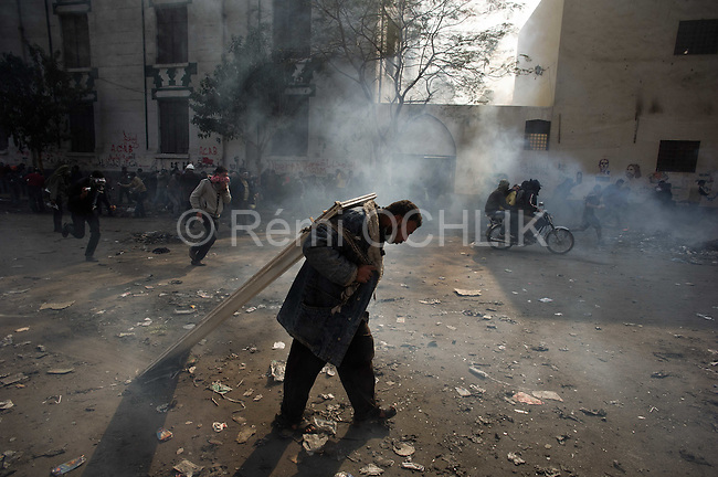 """Remi OCHLIK/IP3 -  Tahrir Square in Cairo November 23, 2011 -   Protesters clash with the anti riot police in the sweet going to the ministry of interior Egypt's ruling military moved up the date for transferring power to a civilian government to July next year and consulted Tuesday with political parties on forming a new Cabinet. But the major concessions were immediately rejected by tens of thousands of protesters in Cairo's iconic Tahrir Square threatening a """"second revolution.  Egyptian troops moved into streets around the Interior Ministry in Cairo on Wednesday, replacing riot police who had repeatedly clashed with protesters trying to reach the building, an army officer said. Riot police withdrew inside the ministry. The removal of the widely hated police seemed to be part of efforts to calm violence that has killed more than 30 people and wounded 2,000 in Cairo and elsewhere in six days of protests targeting the ruling military council, not the army itself. The Interior Ministry, near Tahrir Square, has been the main flashpoint for clashes in which police have fired tear gas, pellets and rubber bullets at stone-throwing demonstrators."""
