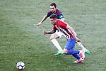 Atletico de Madrid's Jose Maria Gimenez (f) and Club Atletico Osasuna's Miguel de las Cuevas during La Liga match. April 15,2017. (ALTERPHOTOS/Acero)