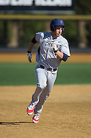 Michael Morman (8) of the Richmond Spiders hustles towards third base against the Wake Forest Demon Deacons at David F. Couch Ballpark on March 6, 2016 in Winston-Salem, North Carolina.  The Demon Deacons defeated the Spiders 17-4.  (Brian Westerholt/Four Seam Images)
