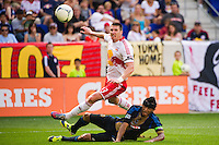 Kenny Cooper (33) of the New York Red Bulls shoots as Carlos Valdes (2) of the Philadelphia Union defends. The New York Red Bulls defeated the Philadelphia Union 2-0 during a Major League Soccer (MLS) match at Red Bull Arena in Harrison, NJ, on July 21, 2012.