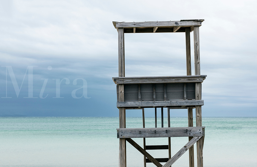 Rustic lifeguard stand overlooking the ocean.
