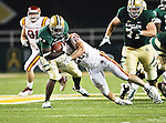 Baylor Bears running back Terrance Ganaway (24) and Iowa State Cyclones linebacker Jake Knott (20) in action during the game between the Iowa State Cyclones and the Baylor Bears at the Floyd Casey Stadium in Waco, Texas. Baylor defeats Iowa State 49 to 26.