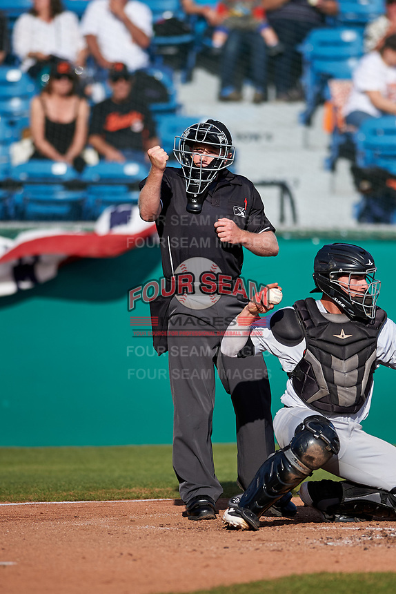 Umpire Chris Presley-Murphy calls a strike during a California League game between the Visalia Rawhide and the San Jose Giants on April 13, 2019 at San Jose Municipal Stadium in San Jose, California. Visalia defeated San Jose 4-2. (Zachary Lucy/Four Seam Images)