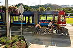 Bikers along side the streetcar at South Waterfront, Portland, Oregon