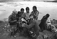 In Bolivia, on the banks of Lake Titicaca, children are employed as fishermen (Photographer Jean Pierre Laffont showing the children Polaroid photos of themselves) - Child labor as seen around the world between 1979 and 1980 – Photographer Jean Pierre Laffont, touched by the suffering of child workers, chronicled their plight in 12 countries over the course of one year.  Laffont was awarded The World Press Award and Madeline Ross Award among many others for his work.