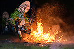 Traditional Baining Fire Dance. Performed by men from the Baining tribe who enter a trance like state and dance around and through the fire in masks thought to resemble insects to contact the spirit world. Baining Mountains, near Kokopo, New Britain,  Papua New Guinea, July 2018.