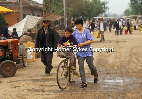 China 1990s. Liufu village a rural community Anhui Province abnormally high ratio of young males result of One Child Policy. 1998 <br /> The Chinese government One Child Policy was introduced to controle the size of the population. As a result many more boys were born. Girls were aborted before birth or died shortly after. Girls were considered to be a much greater expense on the family, especially in rural communities. 97.5% of all abortions were on female fetuses.