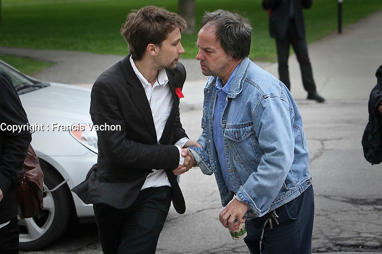A men shakes hand with CLASSE spokesperson Gabriel Nadeau Dubois, left, as he arrives at a meeting with Quebec education Minister Michelle Courchesne in Quebec City Tuesday May 29, 2012. The students and the Quebec government meet for the second day in a row to try to solve a strike over tuition fee that goes for more than 100 days.<br /> <br /> PHOTO :  Francis Vachon - Agence Quebec Presse