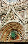 Central Portal Tympanum, 14th c. Bronze Trigram and Gothic Statuary, 13th c. Facade, Giovanni Pisano, Cathedral of Siena, Santa Maria Assunta, Siena, Italy