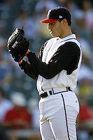 Houston Astros pitcher Andy Pettitte (37) looks to his catcher for the sign during his first rehab start with the Round Rock Express of the Texas League on June 18, 2004 at the Dell Diamond in Round Rock, Texas. (Andrew Woolley/Four Seam Images)