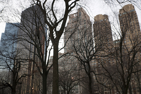 Buildings on Central Park West near Columbus Circle, Viewed thru Trees in Central Park, New York City, New York State, USA