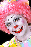 Portrait of colorful clowns in makeup for show to be funny for childre