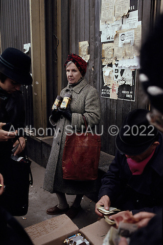 """Moscow, Russia<br /> October 1992<br /> <br /> An elderly woman sells two jars of coffee along a street side. A very common scene in Moscow just after the Soviet Union was disbanded. <br /> <br /> In December 1991, food shortages in central Russia had prompted food rationing in the Moscow area for the first time since World War II. Amid steady collapse, Soviet President Gorbachev and his government continued to oppose rapid market reforms like Yavlinsky's """"500 Days"""" program. To break Gorbachev's opposition, Yeltsin decided to disband the USSR in accordance with the Treaty of the Union of 1922 and thereby remove Gorbachev and the Soviet government from power. The step was also enthusiastically supported by the governments of Ukraine and Belarus, which were parties of the Treaty of 1922 along with Russia.<br /> <br /> On December 21, 1991, representatives of all member republics except Georgia signed the Alma-Ata Protocol, in which they confirmed the dissolution of the Union. That same day, all former-Soviet republics agreed to join the CIS, with the exception of the three Baltic States."""