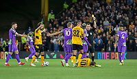 22nd September 2021; Molineux Stadium, Wolverhampton,  West Midlands, England; EFL Cup football, Wolverhampton Wanderers versus Tottenham Hotspur; Tanguy Ndombele of Tottenham Hotspur receives a yellow card from Referee Peter Bankes after a foul on Daniel Podence of Wolverhampton Wanderers