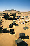 Africa, Libya, Fezzan. Remains of two of three LRDG Chevrolet trucks in a valley of the Gebel Sherif mountains southwest of Kufra. During Second World War on January 31 1941 the Long Range Desert Group was attacked by the Italian Compagnie Sahariane. Libyen 1999/2000.<br /> <br />  --- No releases available. Automotive trademarks are the property of the trademark holder, authorization may be needed for some uses.<br /> <br />  --- INFO: The Long Range Desert Group (LRDG) was a reconnaissance and raiding unit of the British Army during the Second World War. Originally called the Long Range Patrol Unit (LRP), the unit was founded in Egypt in June 1940 by Major Ralph A. Bagnold. Bagnold was assisted by Captain Patrick Clayton and Captain William Shaw. At first the majority of the men were from New Zealand, but they were soon joined by Rhodesian and British volunteers, whereupon new sub-units were formed and the name was changed to the better-known Long Range Desert Group (LRDG).<br /> <br /> The LRDG vehicles were mainly two wheel drive, chosen because they were lighter and used less fuel than four wheel drive. They were stripped of all non-essentials, including doors, windscreens and roofs. They were fitted with a bigger radiator, a condenser system, built up leaf springs for the harsh terrain, wide, low pressure desert tyres, sand mats and channels etc. Initially the LRDG patrols were equipped with one CMP Ford 15 cwt F15 truck for the commander, while the rest of the patrol used up to 10 Chevrolet 30 cwt WB trucks.<br /> <br /> On 31 January 1941 'T' Patrol commanded by Captain Patrick Clayton was attacked by the Compagnia Autosahariana di Cufra, an Italian unit similar to the LRDG, in the Gebel Sherif valley south of Cufra, Libya. The LRDG had one man killed and three men captured, and three of the eleven trucks were destroyed during the battle. The Italians losses were five killed and three wounded, and one truck was abandoned.