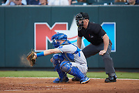 Burlington Royals catcher William Hancock (7) frames a pitch as home plate umpire Lane Culipher looks on during the Appalachian League playoff game against the Pulaski Yankees at Calfee Park on September 1, 2019 in Pulaski, Virginia. The Royals defeated the Yankees 5-4 in 17 innings. (Brian Westerholt/Four Seam Images)