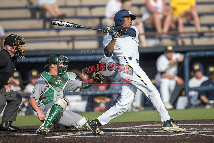 Michigan Wolverines outfielder Johnny Slater (25) follows through on his swing during the NCAA baseball game against the Eastern Michigan Eagles on May 16, 2017 at Ray Fisher Stadium in Ann Arbor, Michigan. Michigan defeated Eastern Michigan 12-4. (Andrew Woolley/Four Seam Images)