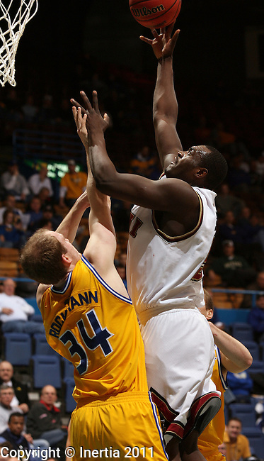 SIOUX FALLS, SD - MARCH 6: Christian Siakam #55 of IUPUI shoots over Max Rockmann #34 of UMKC in the first half during their quarter-final game at the 2011 Summit League Basketball Championships Sunday in Sioux Falls, S.D. (Photo by Dave Eggen/Inertia)