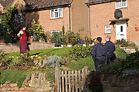 Firefighters delivering fire safety leaflets as part of their community fire safety campaign Oxfordshire UK. This image may only be used to portray the subject in a positive manner..©shoutpictures.com..john@shoutpictures.com
