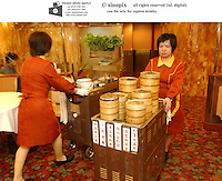 Dim sum waitresses and trolleys at Chiu chow Garden in Hong Kong.