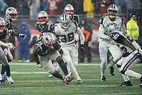 FOXBOROUGH, MA - NOVEMBER 24: Dallas Cowboys Safety Xavier Woods #25 comes in to tackle New England Patriots Runningback Sony Michel #26 during a game between Dallas Cowboys and New England Patriots at Gillettes on November 24, 2019 in Foxborough, Massachusetts.