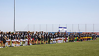 HERRIMAN, UT - JULY 8: The full teams and staff for OL Reign FC and Utah Royals FC line up for the Nation Anthem during a game between OL Reign and Utah Royals FC at Zions Bank Stadium on July 8, 2020 in Herriman, Utah.