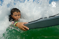 Boy (10-12) surfing in waves, portrait, close-up (Licence this image exclusively with Getty: http://www.gettyimages.com/detail/200482341-001 )