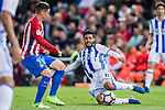 Carlos Alberto Vela Garrido (R) of Real Sociedad battles for the ball with Fernando Torres (L)  of Atletico de Madrid  during their La Liga match between Atletico de Madrid vs Real Sociedad at the Vicente Calderon Stadium on 04 April 2017 in Madrid, Spain. Photo by Diego Gonzalez Souto / Power Sport Images