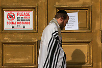 NEW YORK, NEW YORK - OCTOBER 10: A man tries to enter to the closed Young Israel Beth-El of Boro Park Synagogue on October 10, 2020 in Brooklyn New York. Brooklyn federal judge ruled in a lawsuit filed by several Jewish organizations after Gov. Andrew M. Cuomo has placed restrictions on gatherings at synagogues and other houses of worships (Photo by Kena Betancur/VIEWpress via GettyImages)