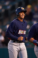 Toledo Mudhens shortstop Dixon Machado (28) jogs back to the dugout after scoring a run on a grand slam home run hit by Jefry Marte (not pictured) during a game against the Rochester Red Wings on May 12, 2015 at Frontier Field in Rochester, New York.  Toledo defeated Rochester 8-0.  (Mike Janes/Four Seam Images)