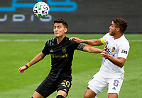 LOS ANGELES, CA - OCTOBER 25: Eduard Atuesta #20 of LAFC battles with Jonathan dos Santos #8 of the Los Angeles Galaxy for a loose ball during a game between Los Angeles Galaxy and Los Angeles FC at Banc of California Stadium on October 25, 2020 in Los Angeles, California.