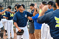 Starting pitcher Justin Brantley (4) of the Columbia Fireflies high-fives teammates before game two of a doubleheader against the Rome Braves on Saturday, August 19, 2017, at Spirit Communications Park in Columbia, South Carolina. Columbia won, 1-0. (Tom Priddy/Four Seam Images)