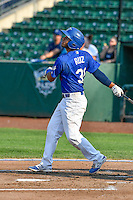 Keibert Ruiz (31) of the Ogden Raptors follows through on his swing against the Idaho Falls Chukars during the Pacific Coast League game at Smith's Ballpark on August 29, 2016 in Salt Lake City, Utah. The Chukars defeated the Raptors 3-0. (Stephen Smith/Four Seam Images)