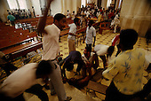Port-au-Prince, Haiti<br /> November 1987<br /> <br /> A suspected ton-ton-macoute is wrestled to the floor in a Cathedral prior to elections held on November 29th, the first attempt at a democratic election in Haiti. It was unsuccessful as 34 people were killed at a polling station and elections were moved up to February 1988.<br /> <br /> Leslie François Manigat won the election with many political parties boycotting. He had military backing but once in office he sought greater control over the military in an effort, to fight corruption. Manigat's government was overthrown by General Henri Namphy within months.