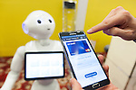 An exhibitor gives a demonstration of Master Card application for payment connecting to robot Pepper during a media event at Pepper World 2016 exhibition on July 20, 2016, Tokyo, Japan. Kenichi Yoshida, vice president of business development for SoftBank Robotics along with other guests spoke about the new features of Pepper such as Chinese response and speech recognition, and duty free tax refunds and electronic payments services, in response to business needs. Pepper for Biz 2.0 press conference was held a day before the start of Pepper World 2016 exhibition, where developers will introduce applications for SoftBank's robot Pepper. Pepper World will run until July 22. (Photo by Rodrigo Reyes Marin/AFLO)