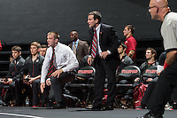 STANFORD, CA - January 18, 2015: Ray Blake and Jason Borrelli  of the Stanford Cardinal wrestling team coaching staff during a meet against Cal Poly at Maples Pavilion. Stanford won 22-13.