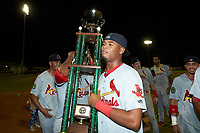 Raffy Ozuna (18) of the Johnson City Cardinals holds the Appalachian League trophy following the win over the Burlington Royals at Burlington Athletic Stadium on September 4, 2019 in Burlington, North Carolina. The Cardinals defeated the Royals 8-6 to win the 2019 Appalachian League Championship. (Brian Westerholt/Four Seam Images)