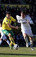 Pictured: Bradley Johnson (L), Michu (R).<br /> Saturday 06 April 2013<br /> Re: Barclay's Premier League, Norwich City FC v Swansea City FC at the Carrow Road Stadium, Norwich, England.