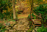 Beuatiful even in fall: Shade garden with handbuilt bench beside stream in autumn, series, Missouri USA