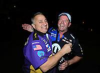Nov. 11, 2012; Pomona, CA, USA: John Nobile (left) congratulates NHRA pro stock driver Allen Johnson who celebrates after winning the Auto Club Finals at at Auto Club Raceway at Pomona. Mandatory Credit: Mark J. Rebilas-