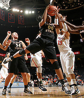 Feb. 7, 2011; Charlottesville, VA, USA; Florida State Seminoles forward Chasity Clayton (00) grabs the rebound in front of Virginia Cavaliers guard Ataira Franklin (23) during the second half of the game at the John Paul Jones Arena. The Florida State Seminoles won 78-74. Mandatory Credit: Andrew Shurtleff-US PRESSWIRE