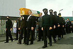 Northern Ireland The Troubles. 1980s. 1981 Teenage IRA paramilitary soldiers in uniform  and disguise attend as guard of honour Joe McDonnells funeral on route to Milltown Cemetery. Belfast UK