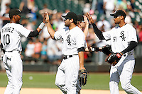 Chicago White Sox Carlos Quentin #20 (middle) high fives Alexis Ramirez #10 with Alex Rios #15 behind him during a game against the Kansas City Royals at U.S. Cellular Field on August 14, 2011 in Chicago, Illinois.  Chicago defeated Kansas City 6-2.  (Mike Janes/Four Seam Images)