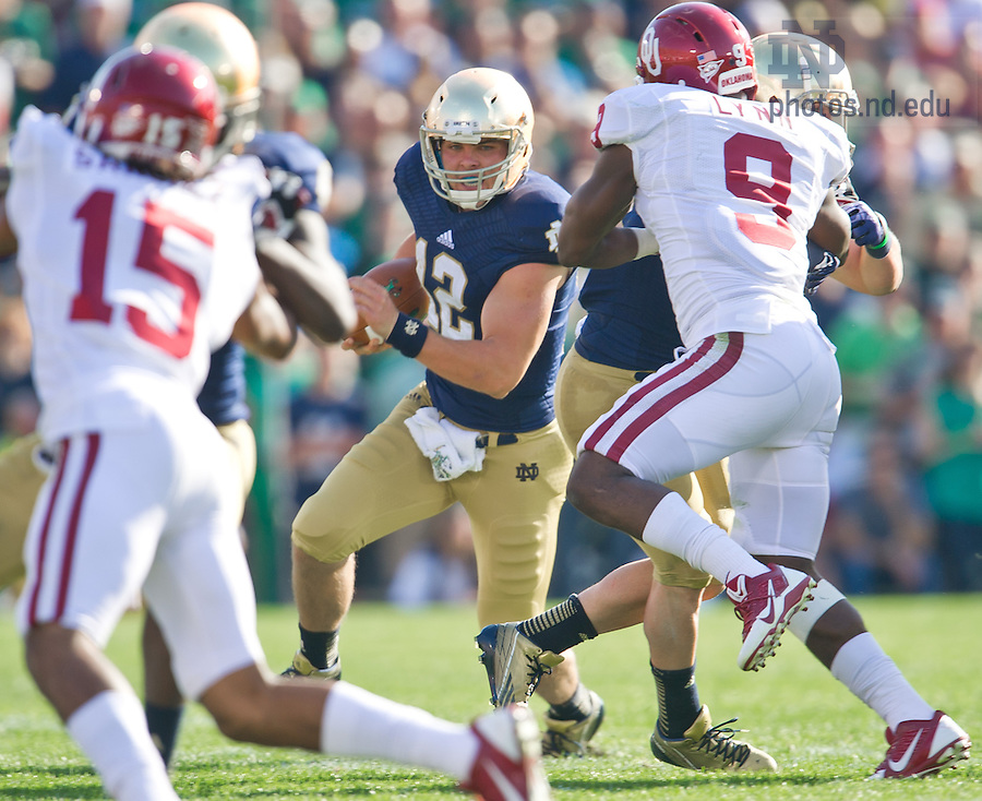 Sept. 28, 2013; Andrew Hendrix (12) carries in the second quarter.<br /> <br /> Photo by Matt Cashore